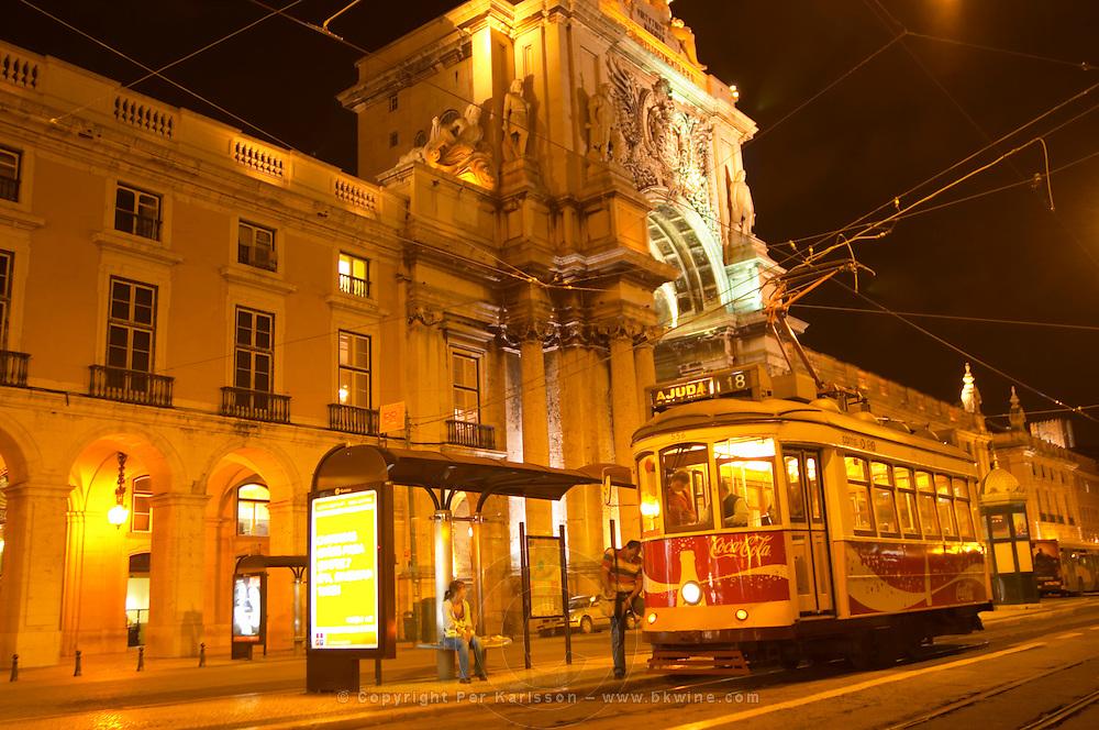 Old tram. Arc de Triomphe baroque style on Praca do Comercio. Lisbon, Portugal