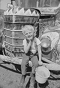 """1006-B076-20 """"Small boy with painted face at Kesey Farm. April 1968"""""""
