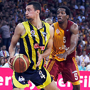Galatasaray's Jerry JOHNSON (R) and Fenerbahce Ulker's Roko Leni UKIC (L) during their Turkish Basketball league Play Off Final third leg match Galatasaray between Fenerbahce Ulker at the Abdi Ipekci Arena in Istanbul Turkey on Thursday 09 June 2011. Photo by TURKPIX