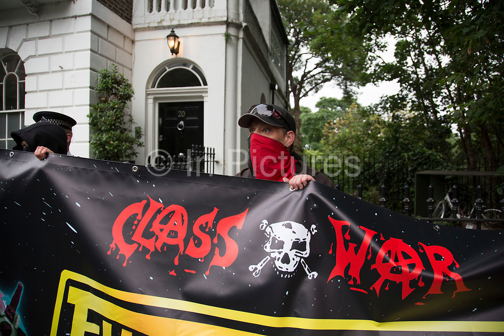 Class War march arrives at Boris Johnson's house in Islington on 15th July in London, United Kingdom. The anarchist group organised this event weeks ago well before Boris Johnson became Foreign Secretary, which has only inflamed the anger amongst protesters at the class and wealth divide between rich and poor and the gentrification of London.