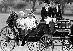 File photo - Burt Reynolds and Loni Anderson are escorted back to their helicopter in an 1800 Visavis coach after the award presentation at Royal Palm Polo in Boca Raton, Fla. on March 15 1987. The driver of the coach is Jim Oberdorf and beside him is daughter Teresa. 1970s' movie heartthrob and Oscar nominee Burt Reynolds has died at the age of 82. He reportedly passed away in a Florida hospital from a heart attack with his family by his side. Photo by Anne Ryan/Sun Sentinel/TNS/ABACAPRESS.COM