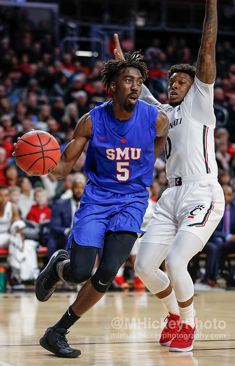 CINCINNATI, OH - JANUARY 28: Emmanuel Bandoumel #5 of the Southern Methodist Mustangs drives to the basket against Chris McNeal #0 of the Cincinnati Bearcats at Fifth Third Arena on January 28, 2020 in Cincinnati, Ohio. (Photo by Michael Hickey/Getty Images) *** Local Caption *** Emmanuel Bandoumel; Chris McNeal