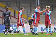 Devarn Green (14) congratulates Charlie Barks (35) for his goal during the Pre-Season Friendly match between Scunthorpe United and Doncaster Rovers at Glanford Park, Scunthorpe, England on 15 August 2020.