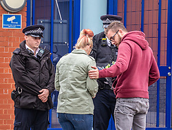 © Licensed to London News Pictures. 25/09/2020. London, UK. A police officer comforts another officer as they lay  flowers for their fallen colleague outside Croydon Police Station in South London where a custody sergeant was shot dead inside the station last night. The Shooter who turned the gun on himself has survived and was taken to hospital in critical condition. Photo credit: Alex Lentati/LNP