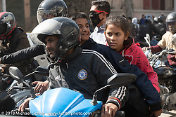 A  father with his two children ride the family motorcycle in the streets of Kathmandu during ourHimalayan Heroes adventure, Nepal. Monday, November 5, 2018. Photography ©2018 Michael Lichter.