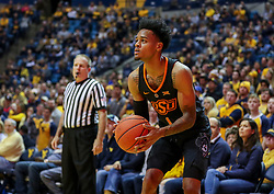 Jan 12, 2019; Morgantown, WV, USA; Oklahoma State Cowboys guard Curtis Jones (1) shoots a three pointer during the first half against the West Virginia Mountaineers at WVU Coliseum. Mandatory Credit: Ben Queen-USA TODAY Sports