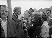 15/05/1982<br /> 05/15/1982<br /> 15 May 1982<br /> An Taoiseach, Mr Charles Haughey, canvasing with Fianna Fail bye-election candidate Eileen Lemass in Dublin West. Taoiseach listens to the voters while on the campaign trail, possibly on Ballyfermot Road?.