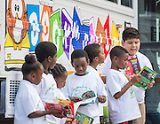 "Students check out the bookmobile during the ""Read Sunnyside Read"" program at Woodson K-8 School, June 11, 2015."