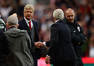 Mark Hughes, the manager of Stoke and Arsene Wenger © , the manager of Arsenal shake hands after the match. Premier league match, Stoke City v Arsenal at the Bet365 Stadium in Stoke on Trent, Staffs on Saturday 19th August 2017.<br /> pic by Bradley Collyer, Andrew Orchard sports photography.