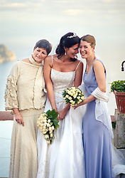 Bride with her sister and mother outdoors
