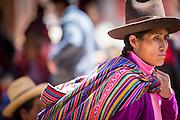 Quechua woman in traditional dress at Chinchero Town Sunday Market, Cusco region, Peru, South America