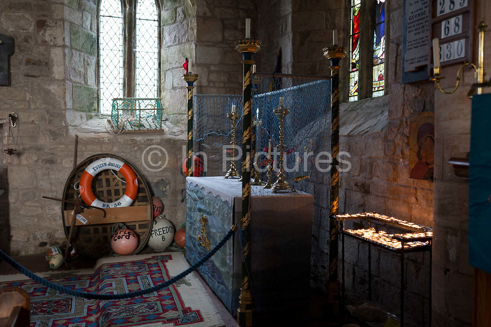 Featuring paraphenalia of local fishing industry, the interior of St. Marys church on Holy Island, on 27th September 2017, on Lindisfarne Island, Northumberland, England. The Holy Island of Lindisfarne, also known simply as Holy Island, is an island off the northeast coast of England. Holy Island has a recorded history from the 6th century AD; it was an important centre of Celtic and Anglo-saxon Christianity. After the Viking invasions and the Norman conquest of England, a priory was reestablished.
