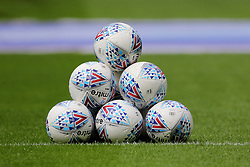 A general view of Championship footballs stacked on the pitch