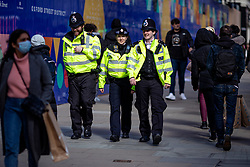 © Licensed to London News Pictures. 12/04/2021. London, UK. Three police officers on patrol along Oxford Street as shoppers return to central London. Pubs, restaurants and non-essential shops reopened on Monday 12 April 2021 as England begins the second phase of 'unlocking' after months of lockdown. Photo credit: Rob Pinney/LNP