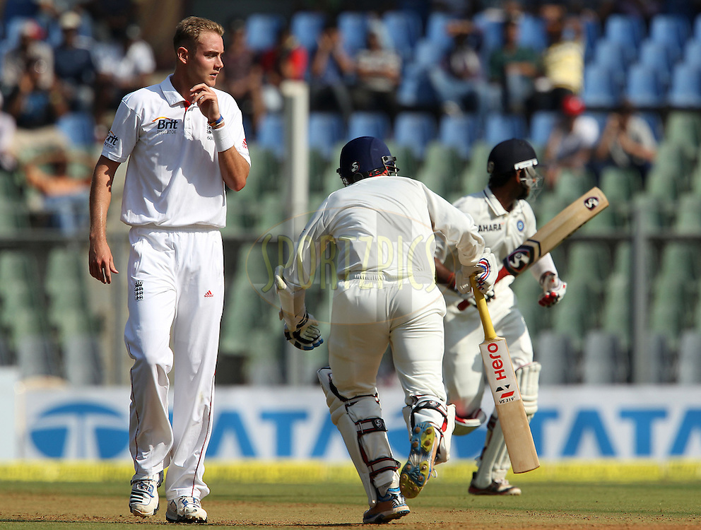 Stuart Broad of England walks back as Cheteshwar Pujara of India and Virender Sehwag of India make the runs during day 1 of the 2nd Airtel Test match between India and England held at the Wankhede Stadium in Mumbai, India on the 23rd November 2012...Photo by Ron Gaunt/ BCCI/ SPORTZPICS..Use of this image is subject to the terms and conditions as outlined by the BCCI. These terms can be found by following this link:..http://www.sportzpics.co.za/image/I0000SoRagM2cIEc