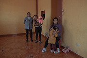 Cinthia Estrada Bolivar (31) and her 3 year old daughter inside her house accompanied by their relatives. During the previous night, her sister Marleny Estrada Bolivar (28) was found buried one and a half meters deep in the room of her house.