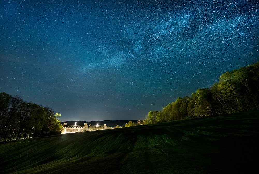 Astro photography taken above Pinchin and Burke halls May 20, 2020 at Colgate University in Hamilton, N.Y. Camera: Nikon D850<br /> Focal length: 15mm<br /> ISO: 1600<br /> Exposure: 20 seconds (buildings exposed for 3 seconds) <br /> F:4.0