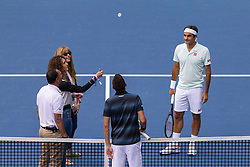 March 25, 2019 - Miami Gardens, FL, USA - Miami Open officials flip a coin before the start of a match between Roger Federer, of Switzerland, and Filip Krajinovic, of Serbia, on Monday, March 25, 2019 at Hard Rock Stadium in Miami Gardens, Fla. (Credit Image: © Matias J. Ocner/Miami Herald/TNS via ZUMA Wire)