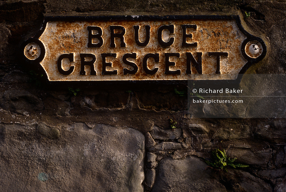 A detail of the stone wall sign for Bruce Crescent in the old area of Ayr in Scotland.