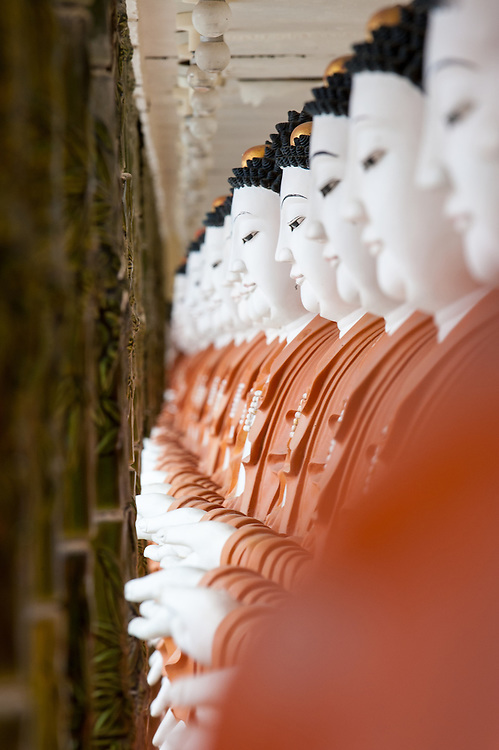 Stock photograph of a line of Buddha statues at the Kek Lok Si temple in Penang, Malaysia