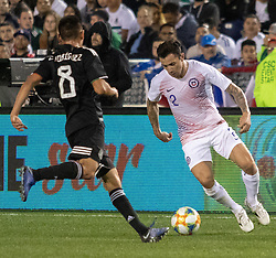 March 22, 2019 - Eugenio Mena (2) of Chile attempts to pass in front of Carlos Rodriguez (8) of Mexico during Mexico's 3-1 victory over Chile. (Credit Image: © Rishi Deka/ZUMA Wire)