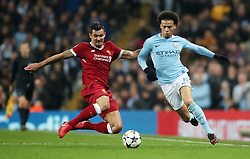 Liverpool's Dejan Lovren and Manchester City's Leroy Sane (right) battle for the ball during the UEFA Champions League, Quarter Final at the Etihad Stadium, Manchester. PRESS ASSOCIATION Photo. Picture date: Tuesday April 10, 2018. See PA story SOCCER Man City. Photo credit should read: Nick Potts/PA Wire