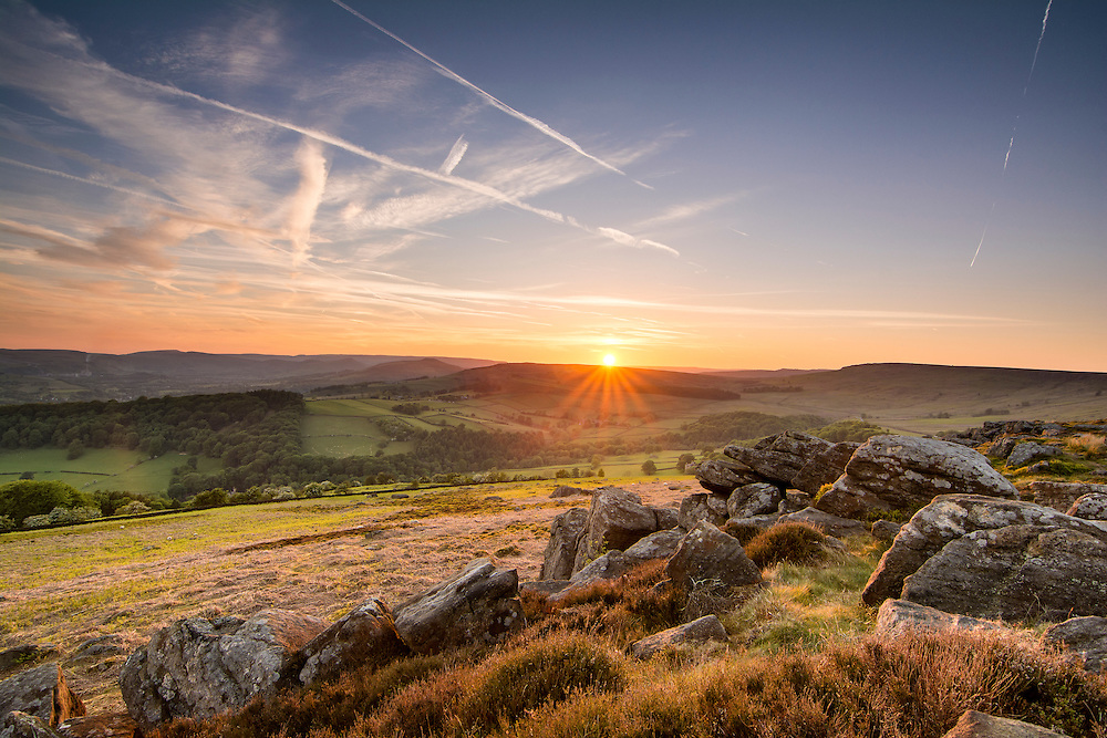 Sun just setting at car head rocks in the Peak District.
