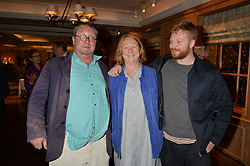 FERGUS & MARGOT HENDERSON and their son HECTOR HENDERSON at a party hosted by Ewan Venters CEO of Fortnum & Mason to celebrate the launch of The Cook Book by Tom Parker Bowles held at Fortnum & Mason, 181 Piccadilly, London on 18th October 2016.
