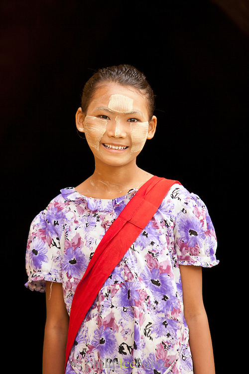 A young girl selling souvenirs wanders around the Maha Aung Mye Bon San Monastery, in the ancient city of Ava in Myanmar