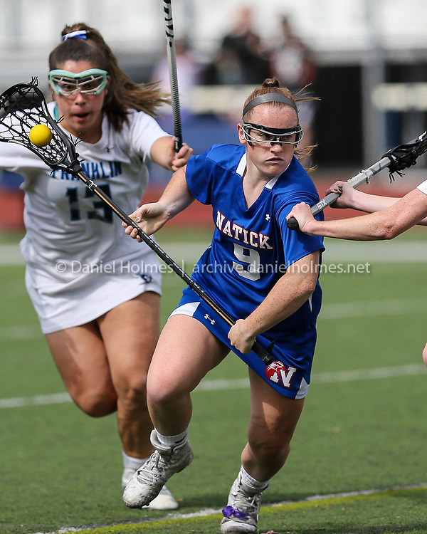 (6/1/17, FRANKLIN, MA) Natick's Annika Streeter blows passed Franklin's Nicole Houlihan during the Div. 1 East girls lacrosse tournament against Franklin at Franklin High School on Thursday. [Daily News and Wicked Local Photo/Dan Holmes]