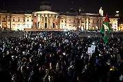 Large protest in Trafalgar square. Thousands of protesters, some masked meet in Trafalgar square and march around central London marking 5th November guy fawkes night, some inceidents were reported and scuffles with the Police in Parliament square, Buckingham palace, Regent Street, Picadilly and Oxford street, London, UK.