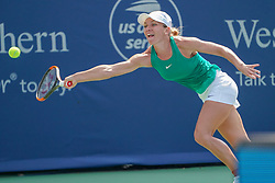 August 19, 2018 - Mason, Ohio, USA - Simona Halep (ROU) reaches for a shot to the corner during Sunday's final round of the Western and Southern Open at the Lindner Family Tennis Center, Mason, Oh. (Credit Image: © Scott Stuart via ZUMA Wire)