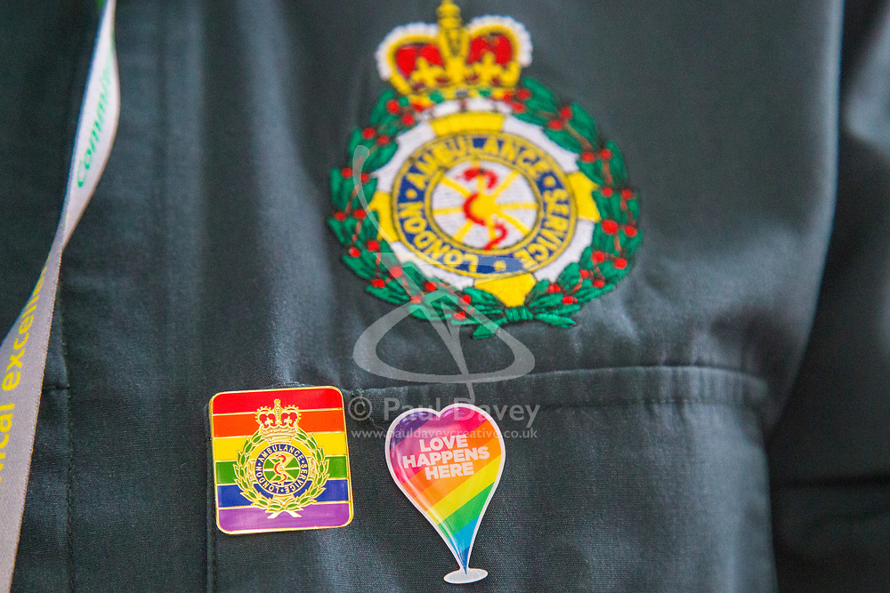 London, July 8th 2017. Thousands of LGBT+ revellers take part in the annual Pride in London parade under the banner #LoveHappensHere. PICTURED: Pride badges on a London Ambulance Service paramedic's uniform.