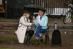 Licensed to London News Pictures. 17/05/2021. London, UK. Pub drinkers make the most of the increased freedoms in Richmond, south west London despite heavy showers as miserable May drags on. Today Government's roadmap out of lockdown continues with pubs, restaurants, cafes and bars able to serve customers inside. However Downing Street has warned that due to the Indian variant, local lockdowns could be quickly reintroduced in high risk areas. Photo credit: Alex Lentati/LNP