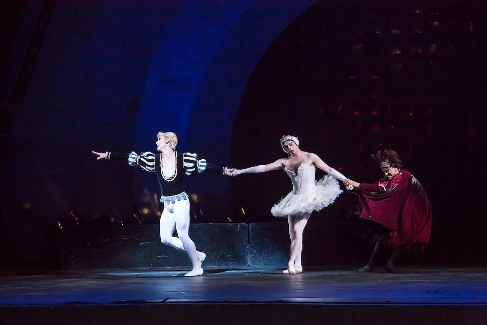 Prince Siegfried, left, pulls Odette away from the sorcerer  Von Rothbart.