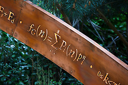 Detail of illuminated mathematical symbols cut into band of copper to form bannister for staircase leading up the belvedere in the Winton Beauty of Mathematics,Chelsea Flower Show 2016.