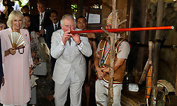 The Prince of Wales is shown how to blow a dart during a visit to the Sarawak Cultural Village, where visitors are encouraged to learn through engaging with culture in Kuching, Sarawak, Malaysia.
