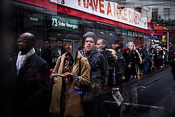 © Licensed to London News Pictures. 09/01/2017. London, UK.  A reflection in a bus shelter shows Long queues of commuters waiting for buses at Victoria station in London on the second day of a 24 hour tube strike.  All Zone one tube stations are closed until 6PM tonight after members of the RMT and the Transport Salaried Staffs' Association unions walked out after talks with TFL collapsed. Photo credit: Ben Cawthra/LNP