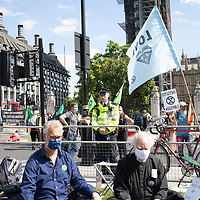 Right Rev. Dr Rowan Williams, former Archbishop of Canterbury, sits in prayer during an Extinction Rebellion demonstration for urgent action on climate change outside Parliament in London.