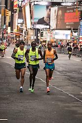 NYRR New York City Half Marathon road race: lead pack of men break away in Times Square, Sambu, Barrios, April