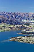 Aerial view of Lake Wanaka and Lake Hawea, with Beacon Point and Dublin Bay in the foreground, and the township of Hawea in the distance.