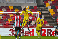 Football - 2020 / 2021 Sky Bet (EFL) Championship - Brentford vs. Wycombe Wanderers  - Brentford Community Stadium<br /> <br /> Admiral Muskwe (Wycombe Wanderers) rise high to head on a chance <br /> <br /> COLORSPORT/DANIEL BEARHAM