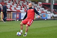 Stevenage defender Scott Cuthbert(5)  warming up during the EFL Sky Bet League 2 match between Stevenage and Cheltenham Town at the Lamex Stadium, Stevenage, England on 20 April 2021.