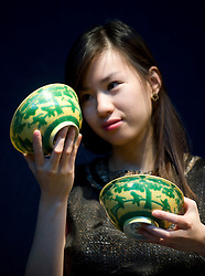 © London News Pictures. 04/11/2011. London, UK. A pair of yellow and green glazed 'Boys' bowls (1723-1735) estimated to fetch up to £120,000 at a Christie's auction of Fine Chinese Ceramics and Works of Art on November 8th 2011. The auction, which is led by seven private collections, is expected to realise in excess of £15 million. Photo Credit : Ben Cawthra/LNP