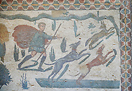 Hunter with dogs chasing a fox from the Room of The Small Hunt, no 25 - Roman mosaics at the Villa Romana del Casale which containis the richest, largest and most complex collection of Roman mosaics in the world, circa the first quarter of the 4th century AD. Sicily, Italy. A UNESCO World Heritage Site. .<br /> <br /> If you prefer to buy from our ALAMY PHOTO LIBRARY  Collection visit : https://www.alamy.com/portfolio/paul-williams-funkystock/villaromanadelcasale.html<br /> Visit our  ROMAN MOSAICS  PHOTO COLLECTIONS for more photos to buy as buy as wall art prints https://funkystock.photoshelter.com/gallery/Roman-Mosaics-Roman-Mosaic-Pictures-Photos-and-Images-Fotos/G00008dLtP71H_yc/C0000q_tZnliJD08