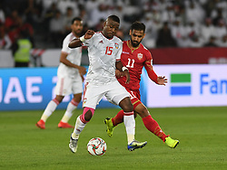 ABU DHABI, Jan. 6, 2019  Ismail Salem Alhammadi (L) of the United Arab Emirates vies the Bahrain's Ali Jaafar Madan.    during the opening match of the AFC Asian Cup UAE 2019 in Abu Dhabi, the United Arab Emirates (UAE), on Jan. 5, 2019. The match ended in a 1-1 draw. (Credit Image: © Xinhua via ZUMA Wire)