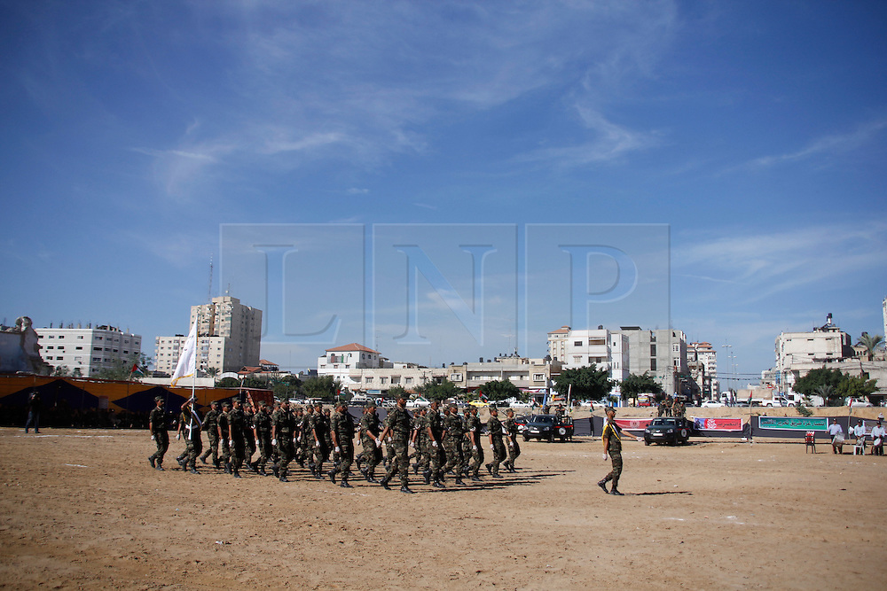 © London News Pictures. 02/12/2012. Gaza. Hamas security officers parade during a graduation ceremony in the destroyed Al-Saraya headquarters in Gaza City on December 02, 2012. Photo credit: Ahmed Deeb/LNP