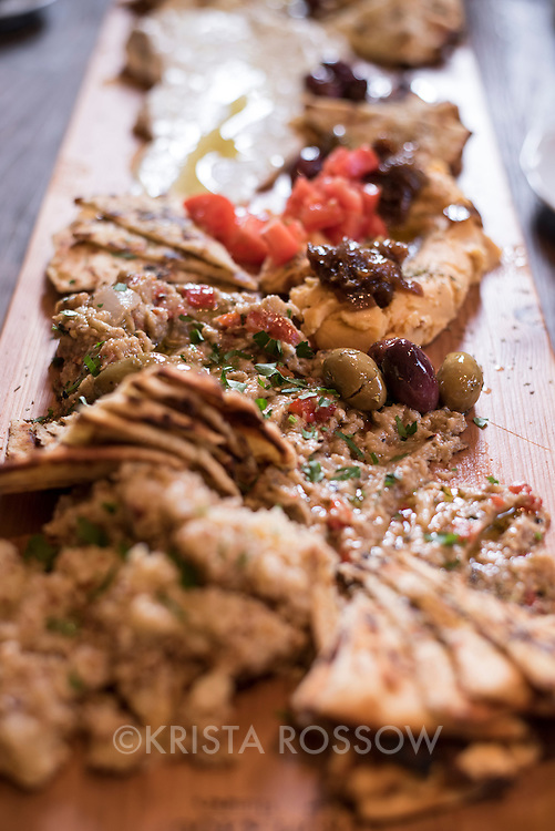 """Mezze board with olives, pita, hummus, and baba ganoush at the Golden Fleece, a Greek-inspired """"slow earth kitchen"""" restaurant run by Greek chef George Delidimos located at 111 Grovewood Road in Asheville, North Carolina."""