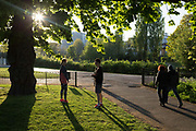 As the UK governments Coronavirus pandemic lockdown continues, and <br /> a further 823 people have died in hospitals across the UK in a day, taking the total to 17,337, Londoners practice social distancing during their daily exercise in late afternoon in Rsukin Park, a public green space in the borough of Lambeth, on 21st April 2020, in London, England.