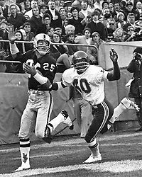 Oakland Raiders Fred Biletnikoff ready to gather in TD pass over Kansas City defender, Jim Marsalis.<br /> (photo by Ron Riesterer)